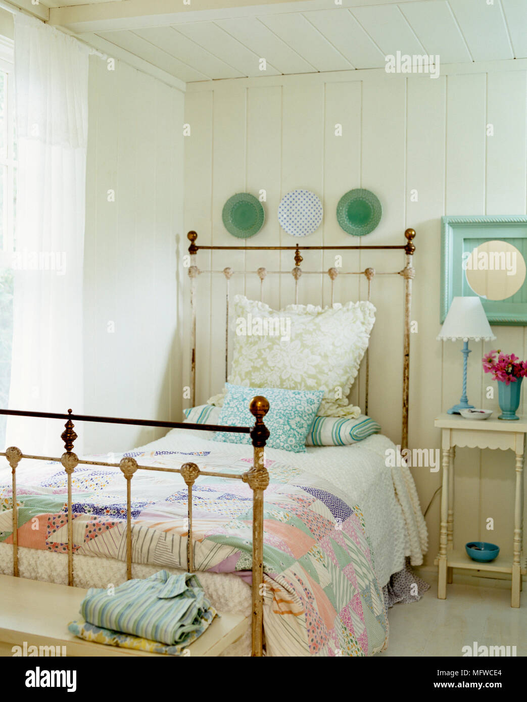 Old fashioned brass single bed in country style bedroom Stock Photo ...