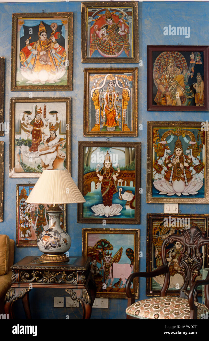 Collection of images of Indian deities displayed on wall - Stock Image