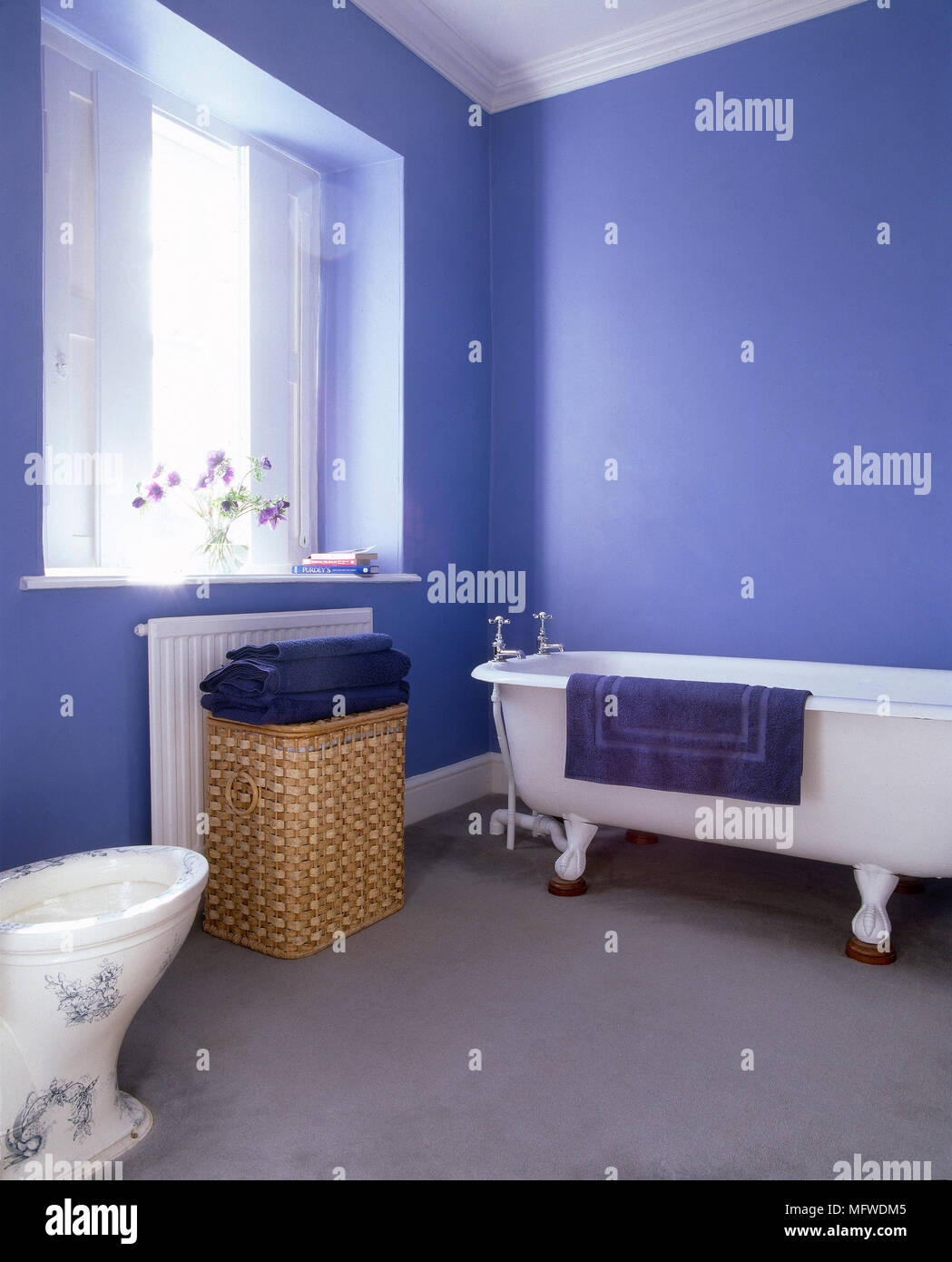Blue bathroom with freestanding roll top bathtub and decorated ...