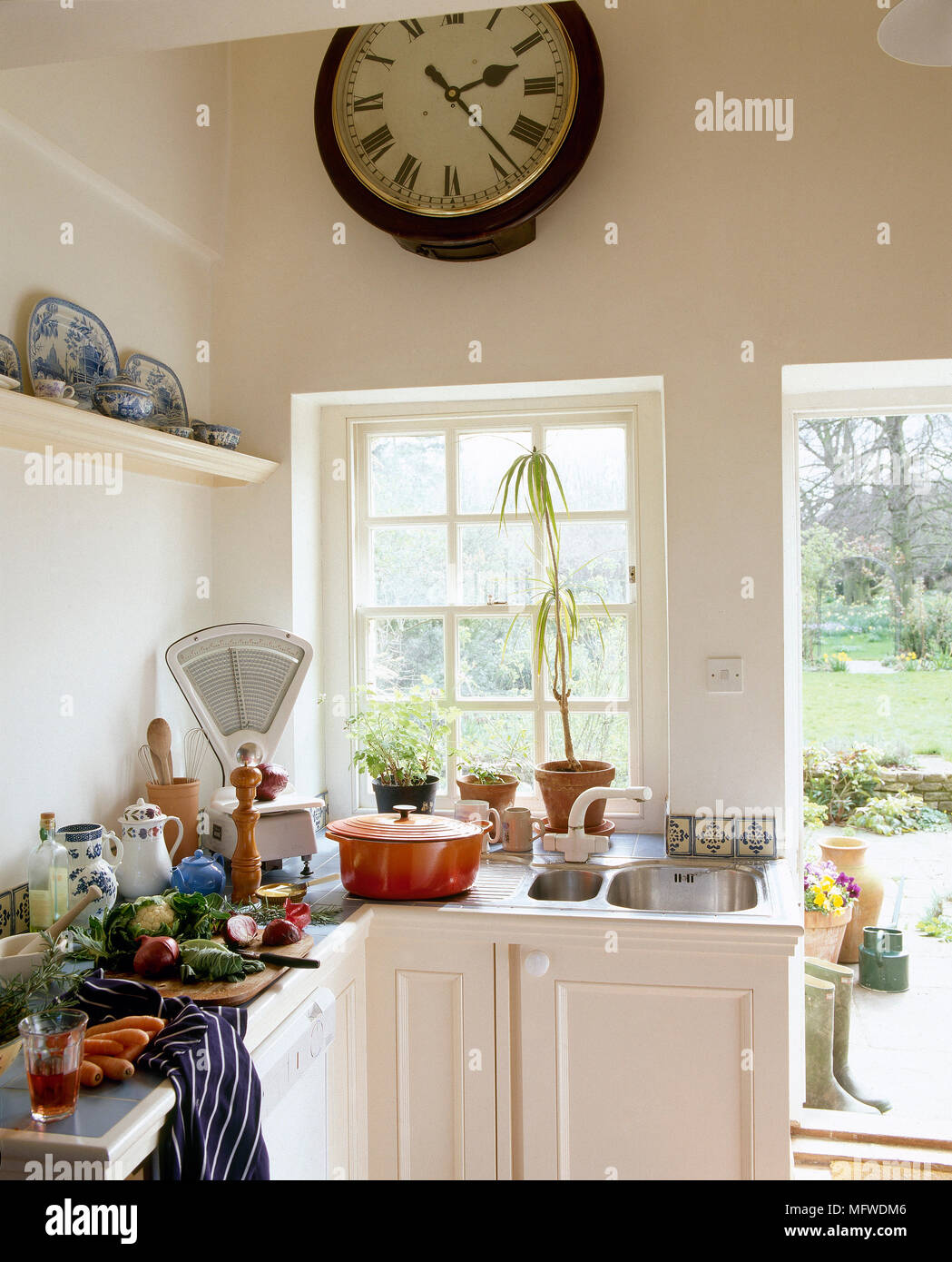 Astounding Country Style Kitchen With White Units And Clock Above Bralicious Painted Fabric Chair Ideas Braliciousco