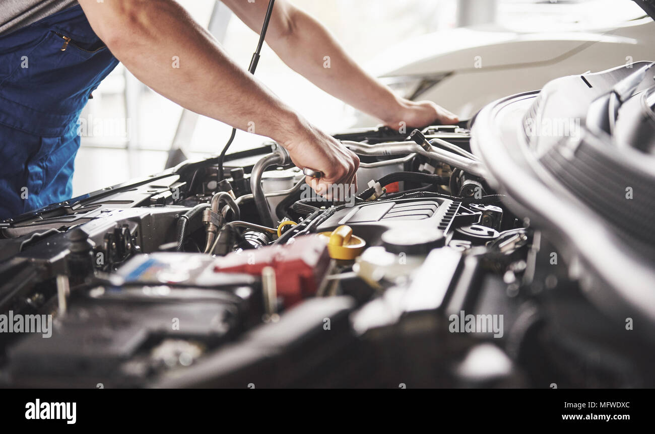 Auto mechanic working in garage. Repair service - Stock Image