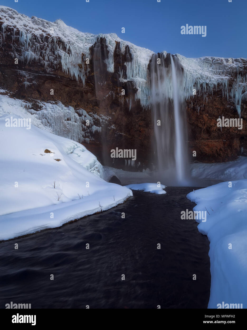 Frozen Seljalandsfoss waterfall in winter in south Iceland Stock Photo