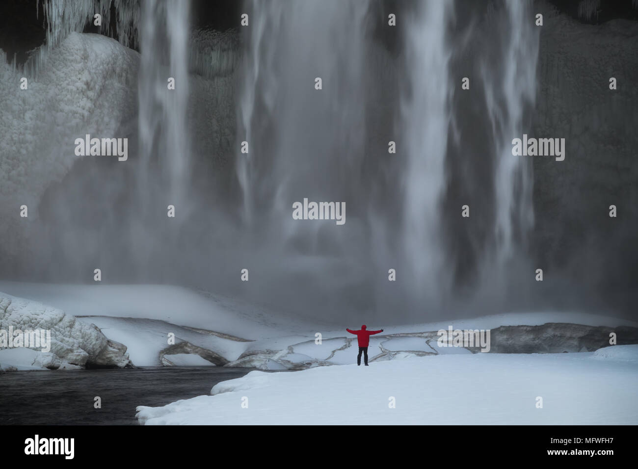 Selfie at Skogafoss waterfall in winter, Iceland - Stock Image