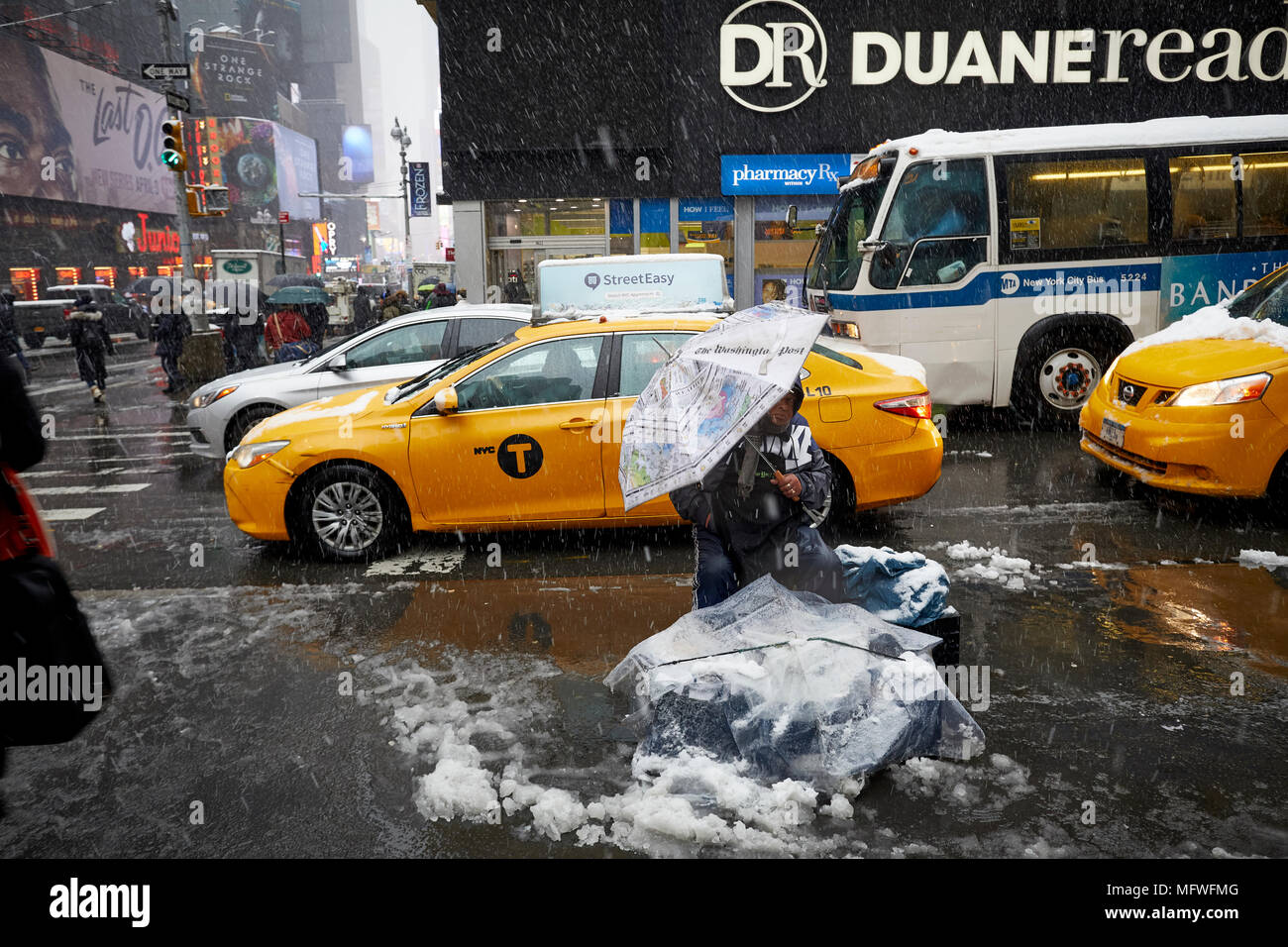Manhattan in New York City , Street pavement  trader covered by a snow fall near Times Square - Stock Image