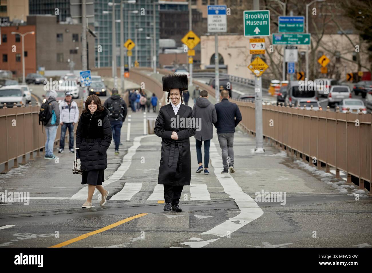 Brooklyn in New York City, Orthodox Judaism wearing shtreimel fur hat  Jewish holiday Pesach passover on Brooklyn Bridge - Stock Image