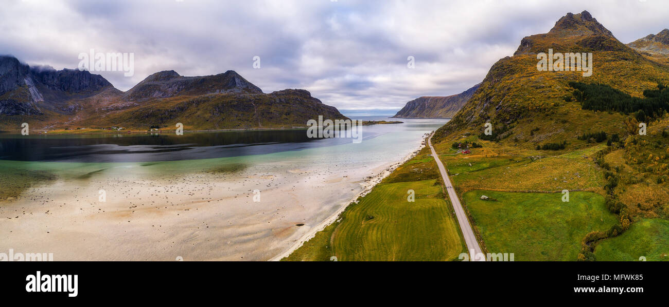Scenic road along the coastline and mountains on Lofoten islands - Stock Image