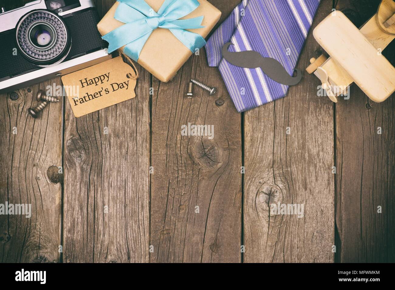 Happy Fathers Day Gift Tag With Top Border Of Gifts Ties And Decor On A Rustic Wood Background View Vintage Styling