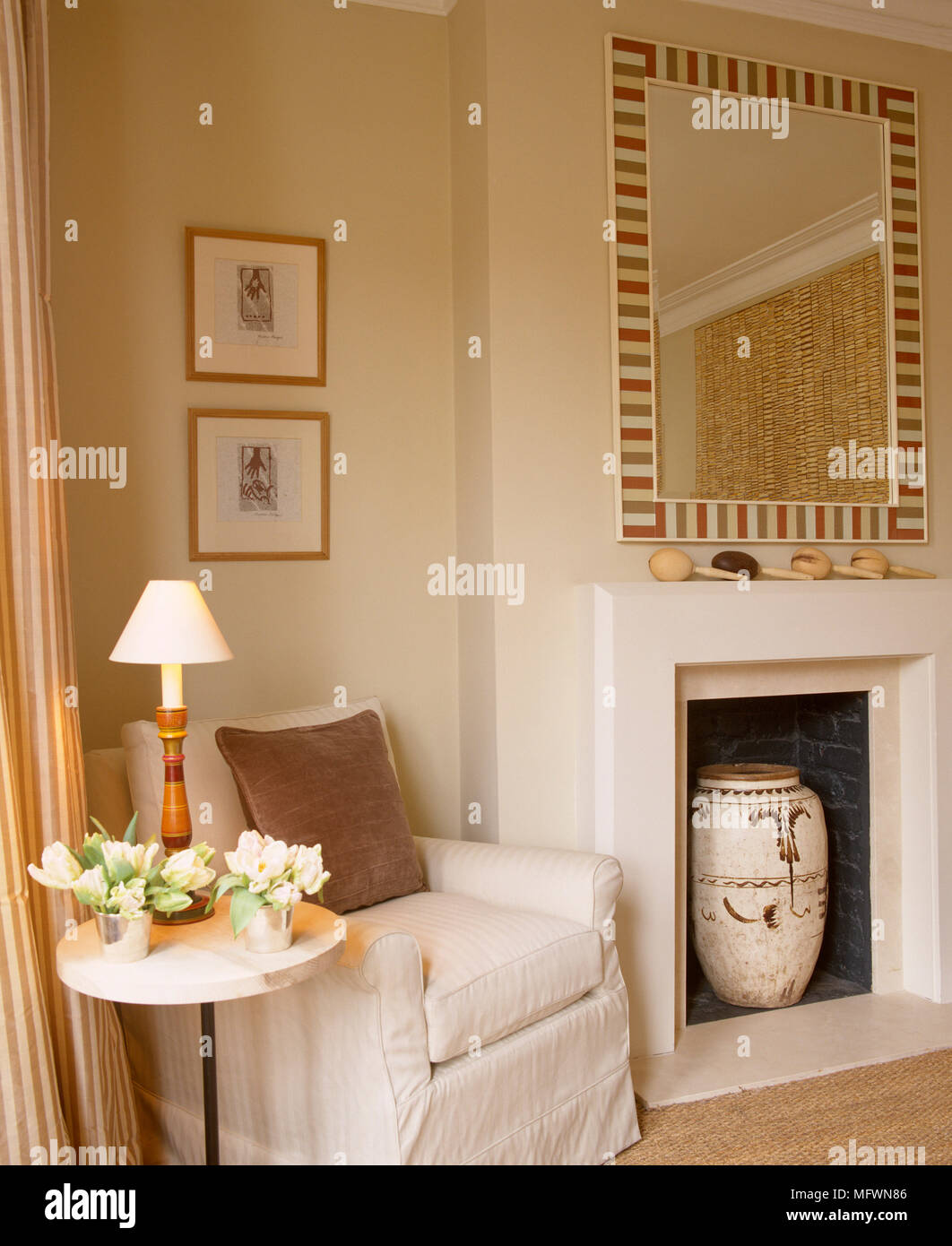 Upholstered Armchair Next To Fireplace In Neutral Colour Sitting Room Area  Of Bedroom