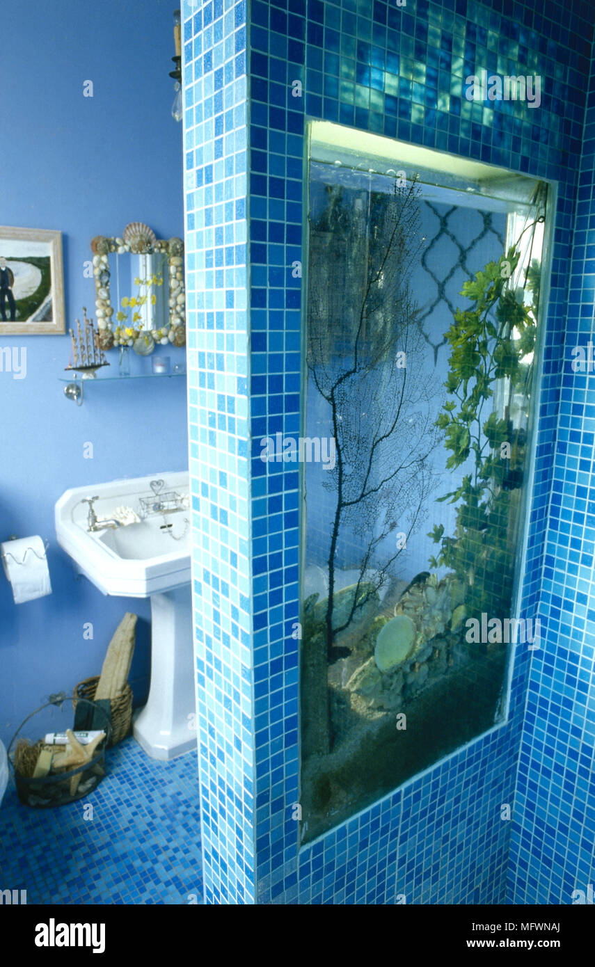 Modern bathroom detail with blue glass tile walls and floor, built ...