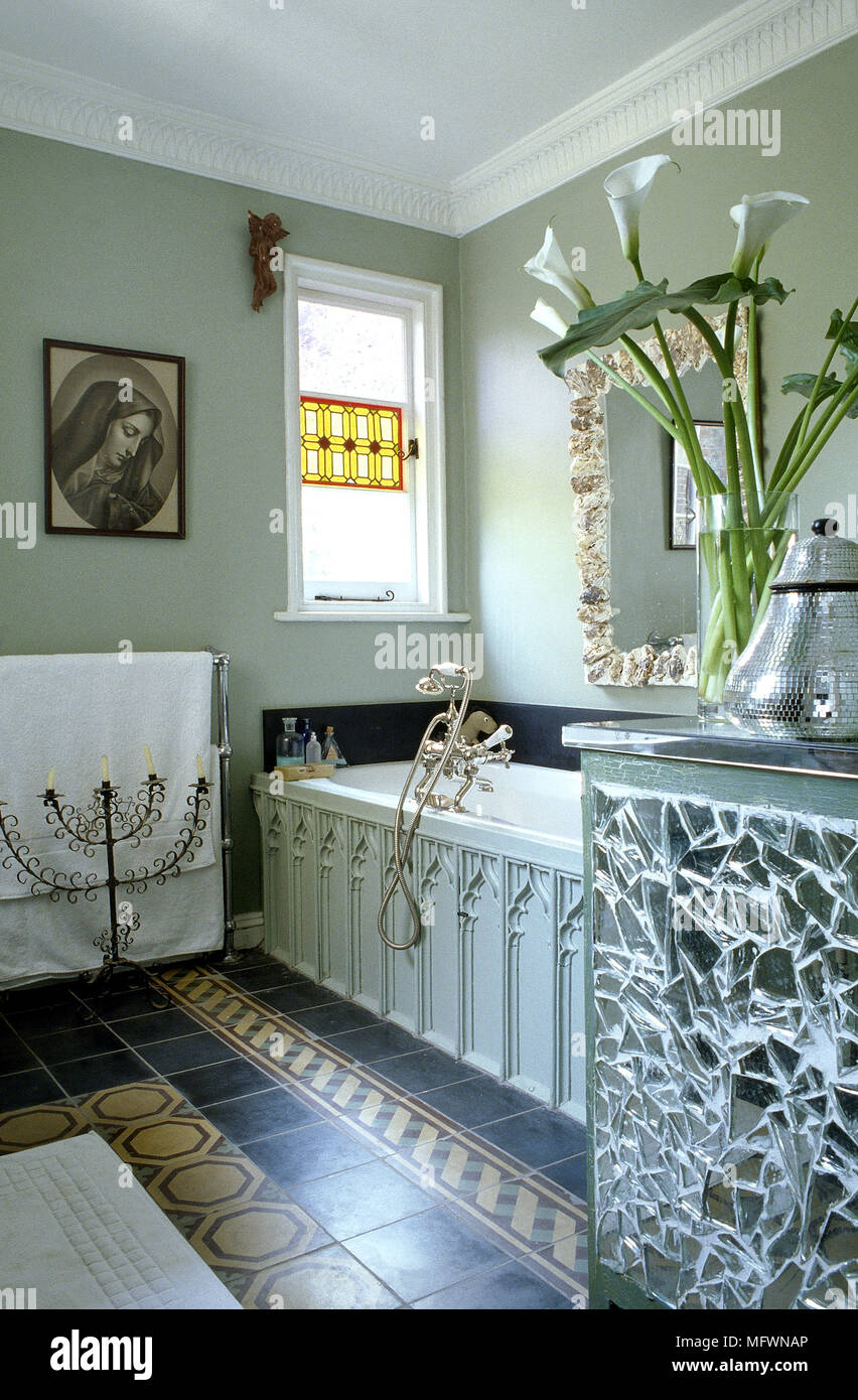 Eclectic bathroom detail with wood panelled bathtub, tile floor ...