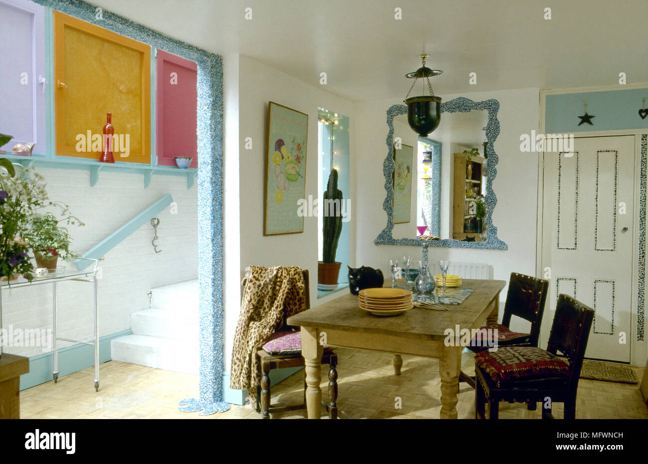 Eclectic Dining Room With Decorative Paint Accents, Wooden Dining Table And  Chairs, And A Doorway To An Adjacent Hallway.