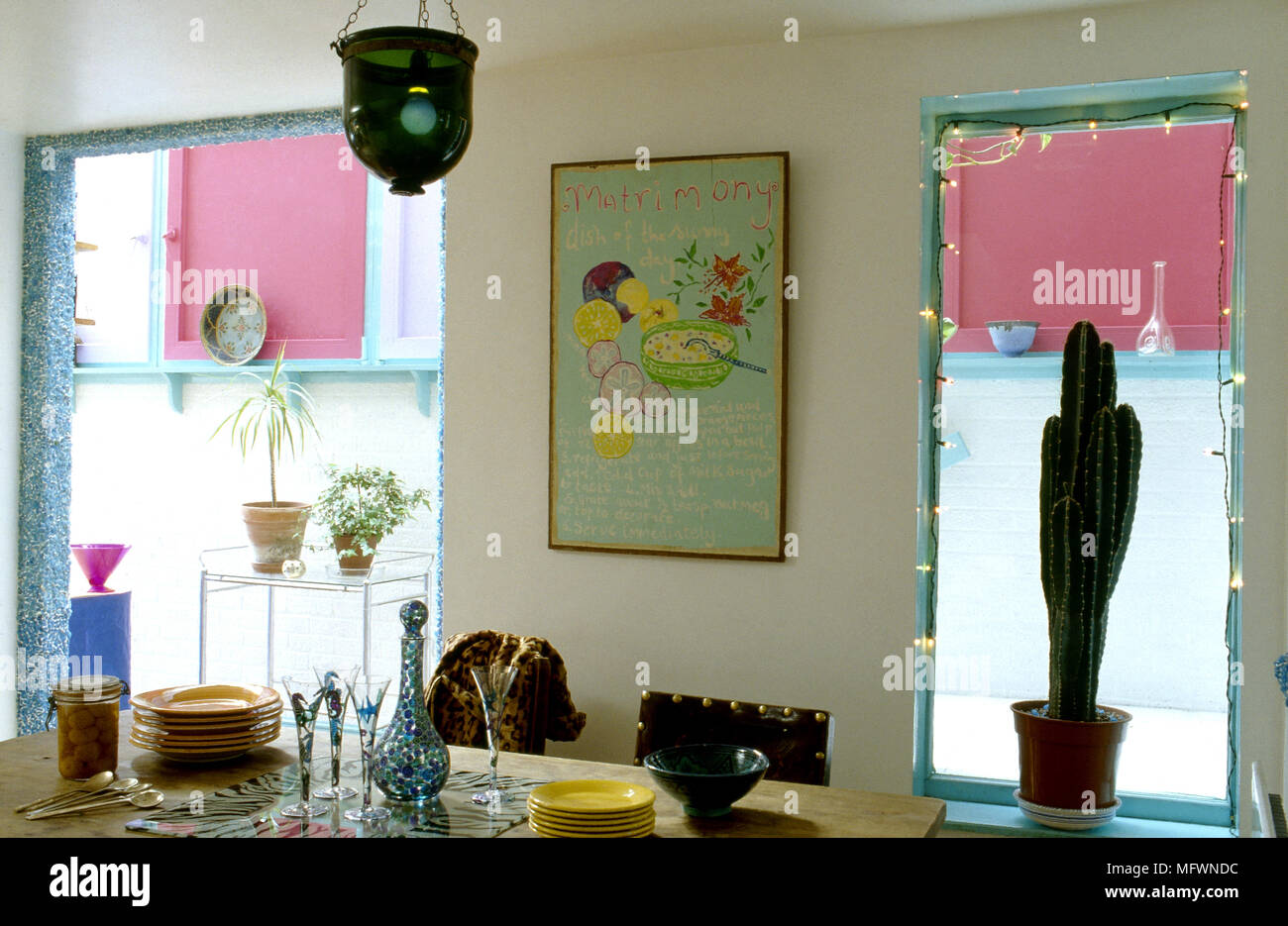 Eclectic Dining Room With Wood Dining Table And Assorted ...