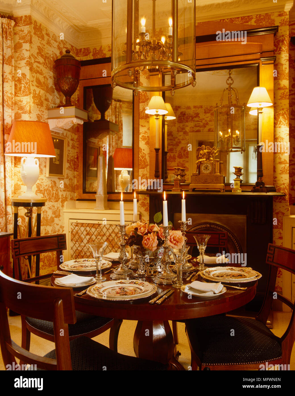 Table set for dinner in traditional style dining room with red ...