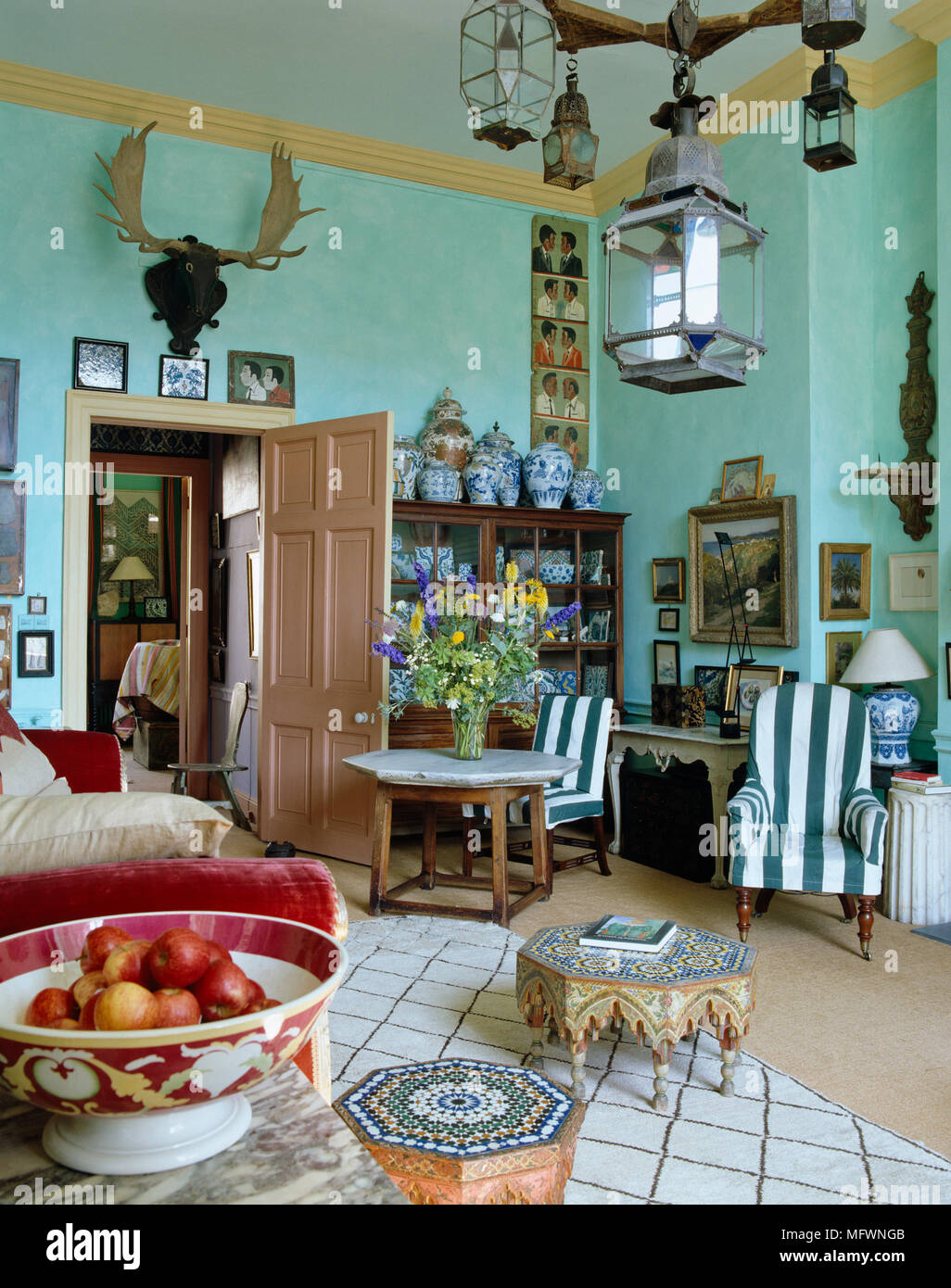 An eclectic mix of furniture in cluttered country style blue ...