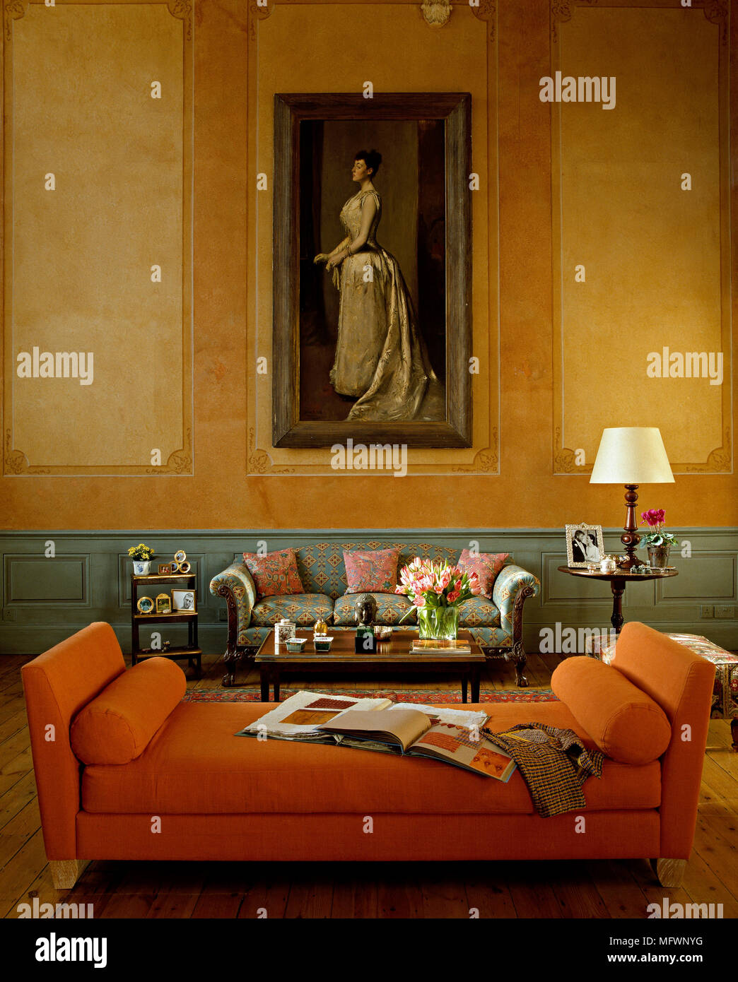 Detail Of A Traditional Sitting Room With Decorative Painted Walls,  Upholstered Daybed And Sofa, High Ceilings And A Large Portrait Painting.