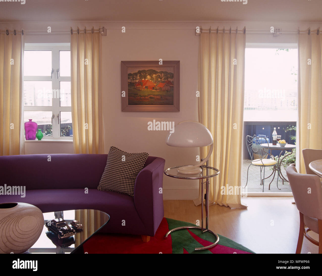 Pleasing Purple Sofa Next To Eileen Gray Steel And Glass Side Table Theyellowbook Wood Chair Design Ideas Theyellowbookinfo