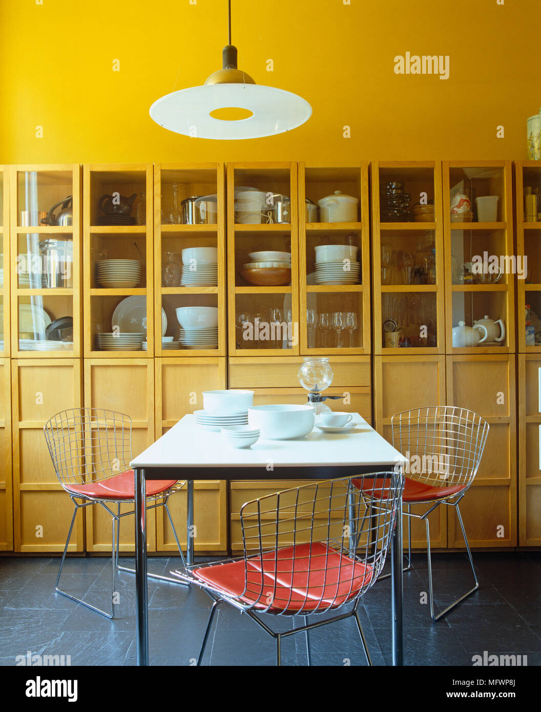 Harry bertoia wire chairs at table in contemporary yellow dining harry bertoia wire chairs at table in contemporary yellow dining room keyboard keysfo Image collections