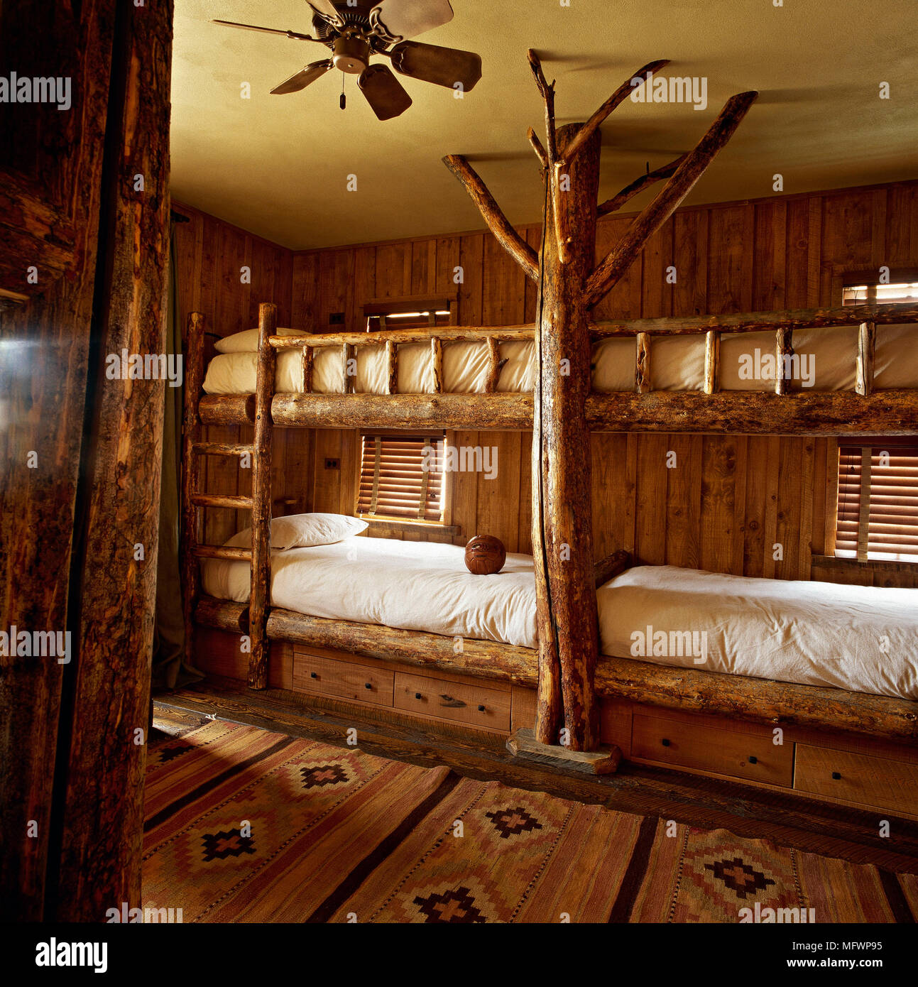 Bedroom With Timber Bunk Beds And Wooden Panelling On Wall Stock Photo Alamy