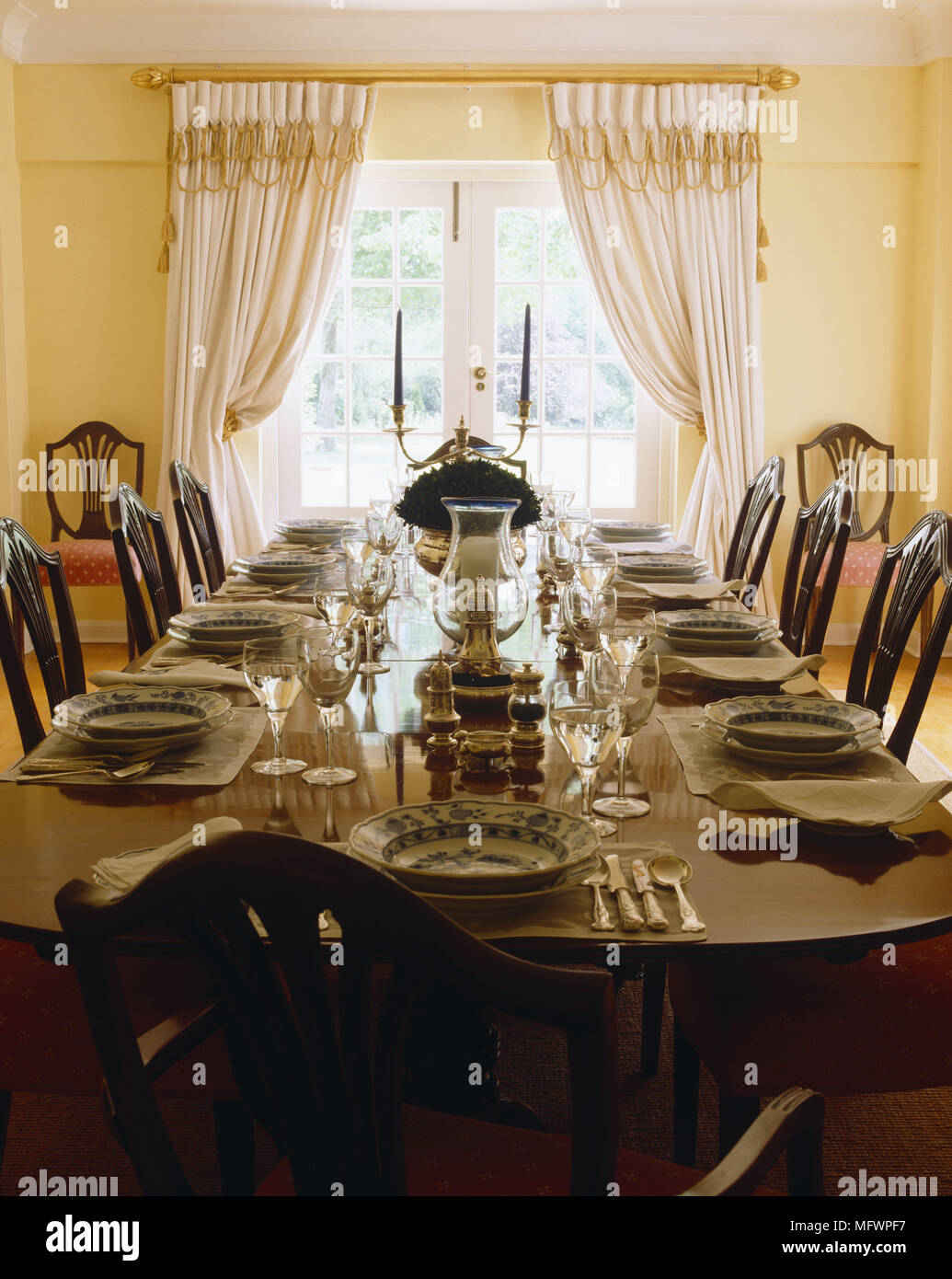 Table Set For Dinner Party In Formal Yellow Dining Room Stock Photo Alamy