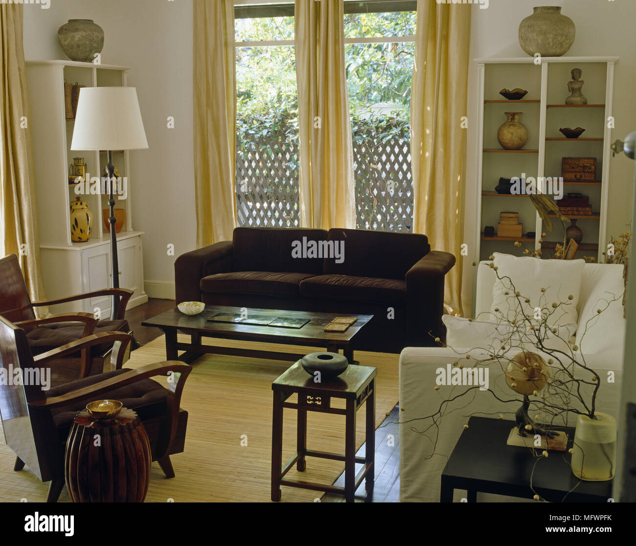 Upholstered Sofa And Chairs Around Coffee Table In Front Of Window