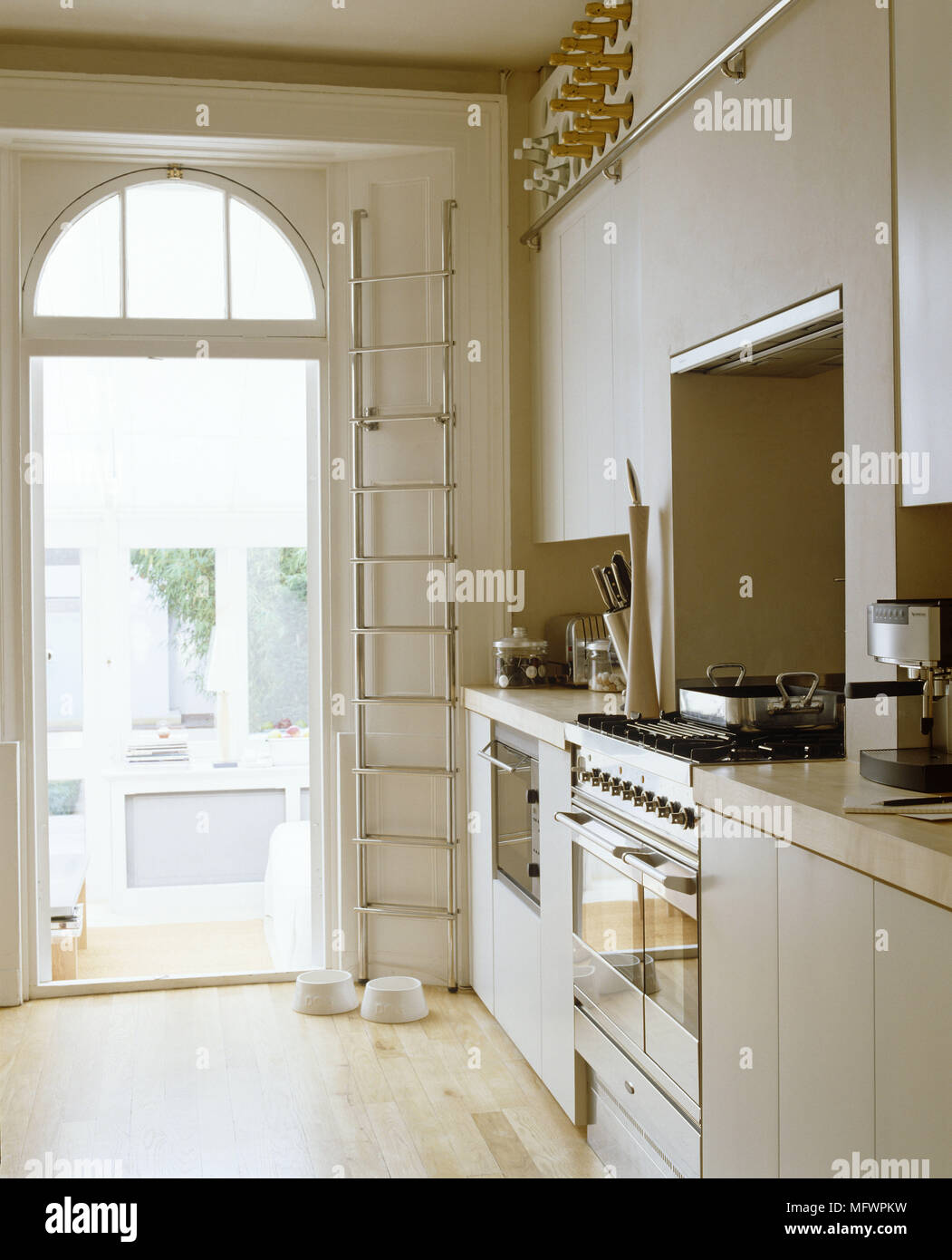 Integral oven in recess in kitchen in neutral colours - Stock Image