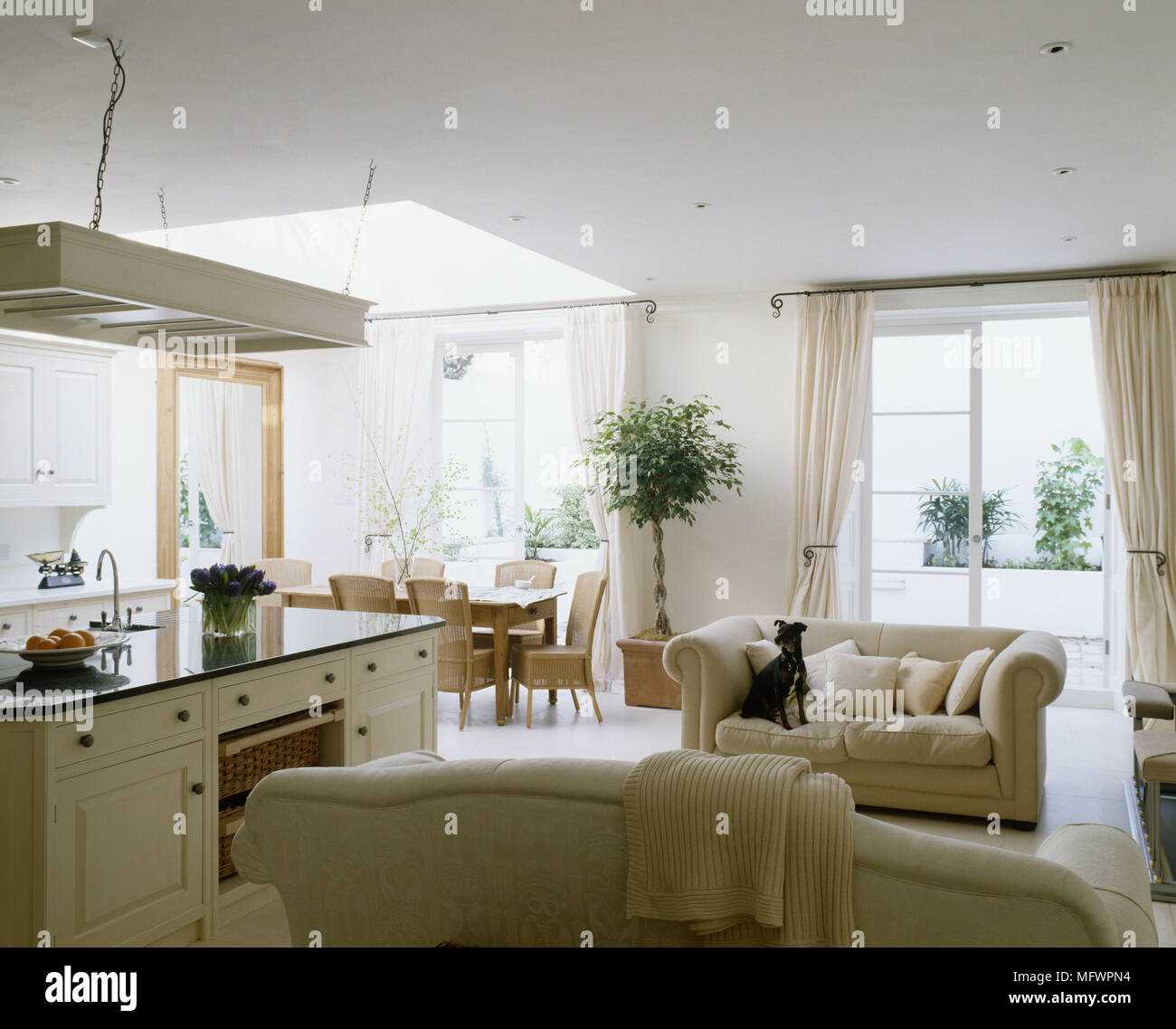 Light and airy open plan kitchen and dining room with extractor fan ...