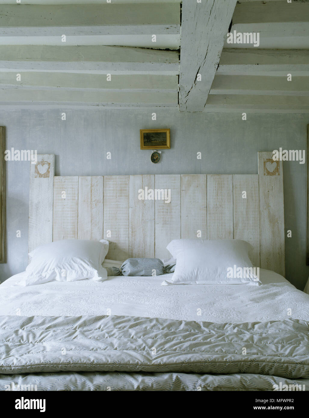 Rustic Bedroom With Double Bed With White Linen And Wooden Headboard Stock Photo Alamy