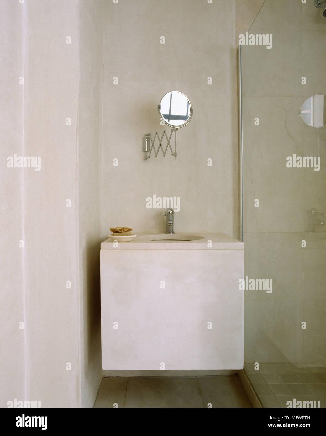 Minimalist Bathroom With Shaving Mirror Mounted Above Washbasin Next To Glass Shower Screen Stock Photo Alamy