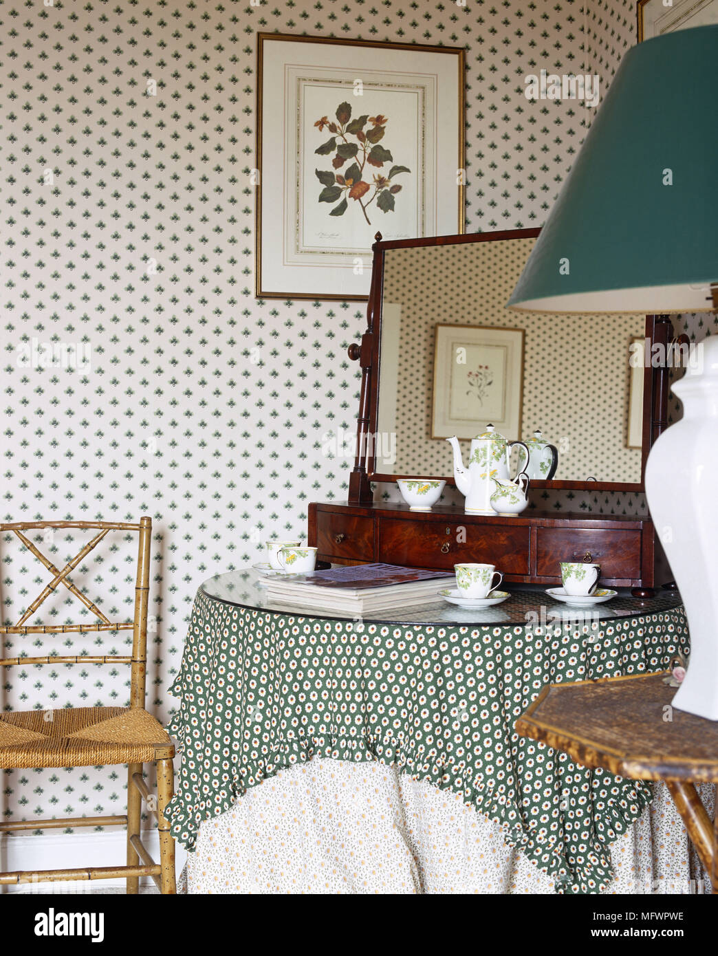 Dressing Table With Mirror And Teaset Next To Wallpapered Wall With Framed  Floral Print And Table