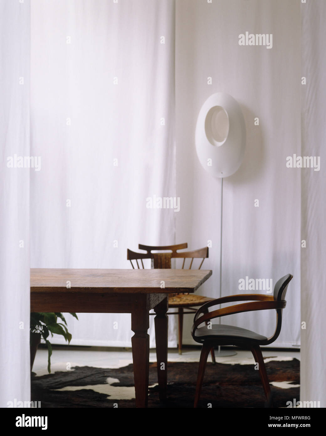 Bon Wooden Table And Chairs On Animal Skin Rug In Front Of White Curtain