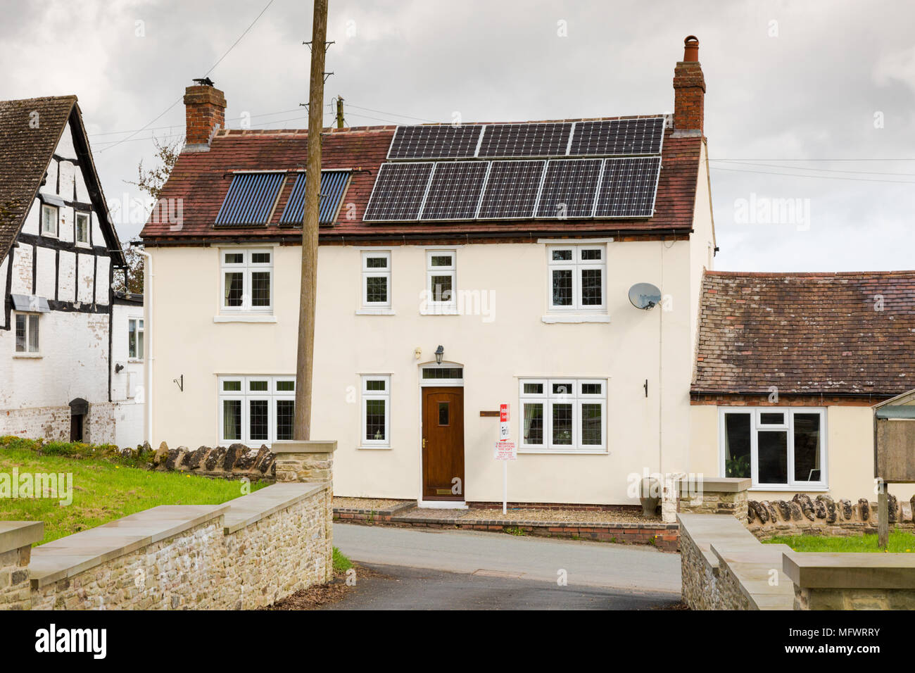 House in Worcestershire with solar panels on the roof, UK - Stock Image