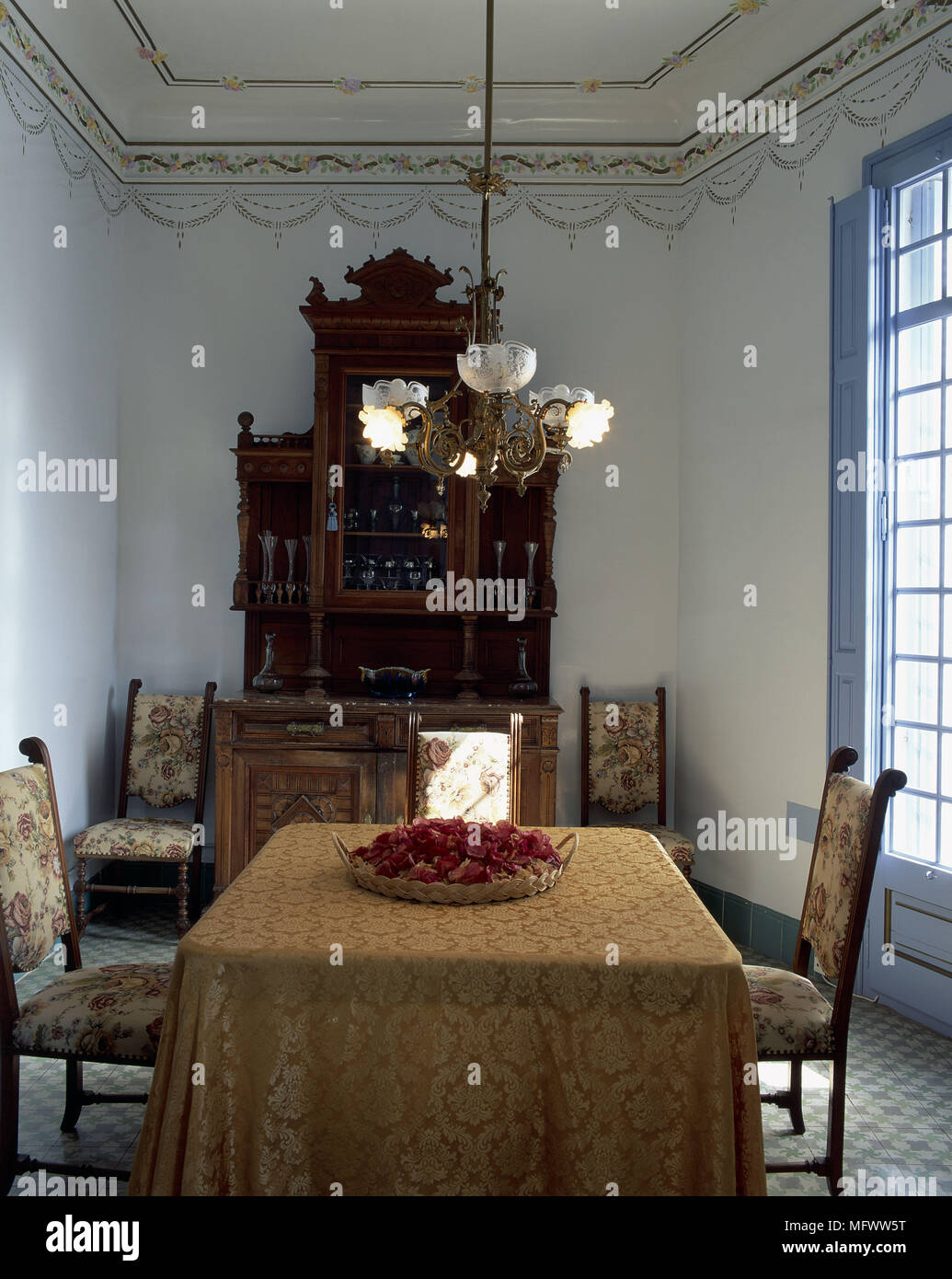 A chandelier stock photos a chandelier stock images alamy view of a chandelier hanging over a dining table stock image arubaitofo Choice Image