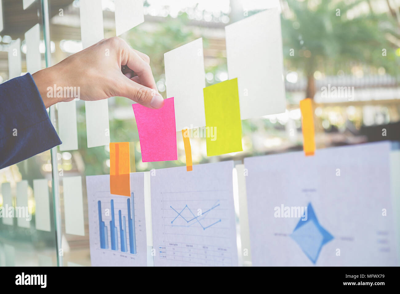 Note paper reminder schedule board. Business people meeting and use post it notes to share idea. Discussing - business, teamwork, brainstorming concep - Stock Image