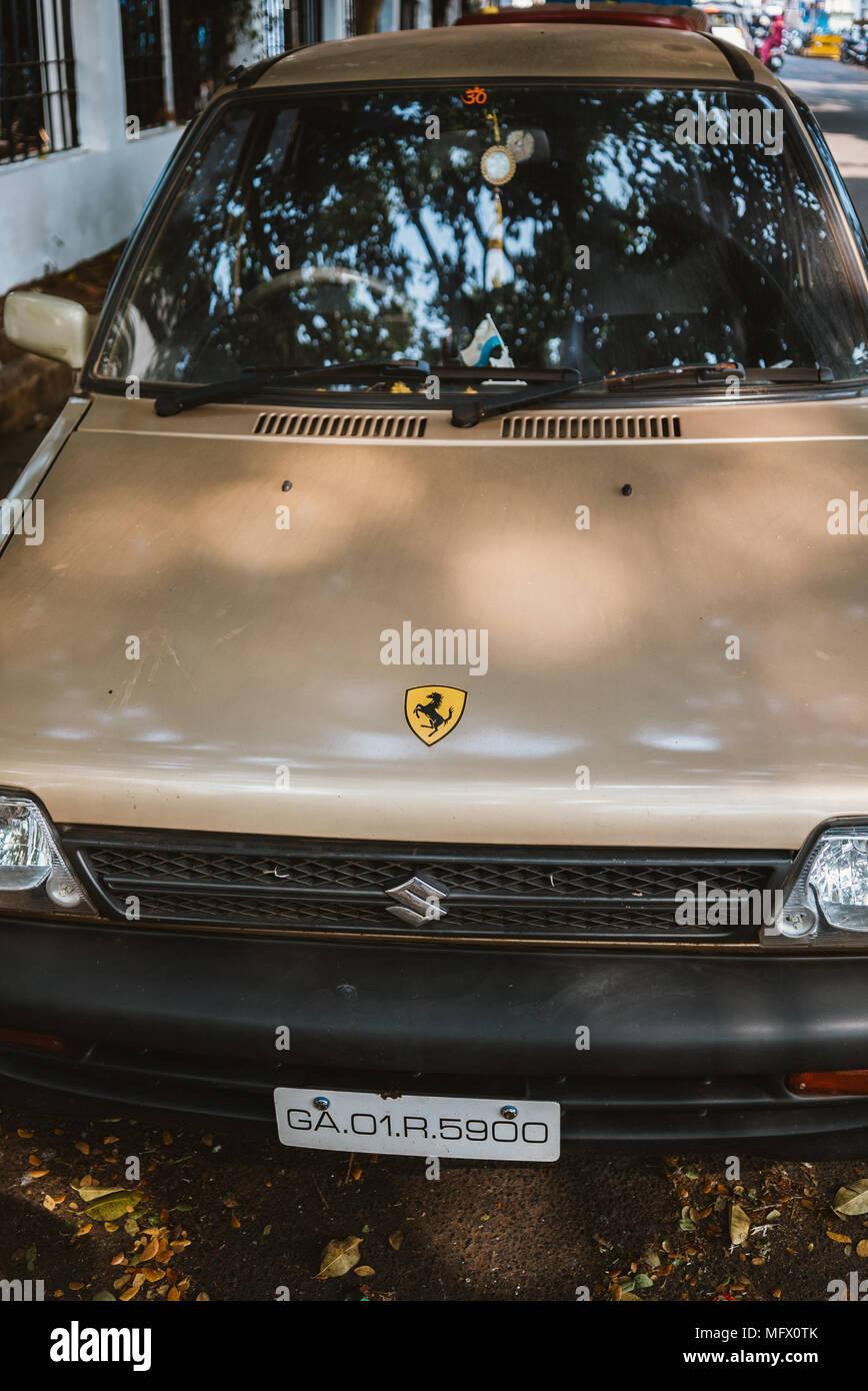 Old suzuki with ferrari sticker parked on street in panaji goa india stock