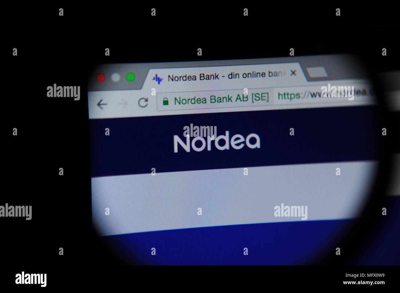Nordea website seen through a Magnifying glass - Stock Image