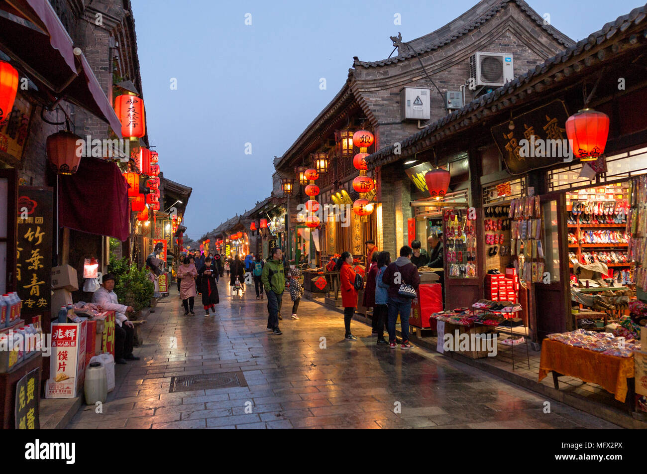 Tourists and local people in the ancient city of Pingyao in central China, Asia. Stock Photo
