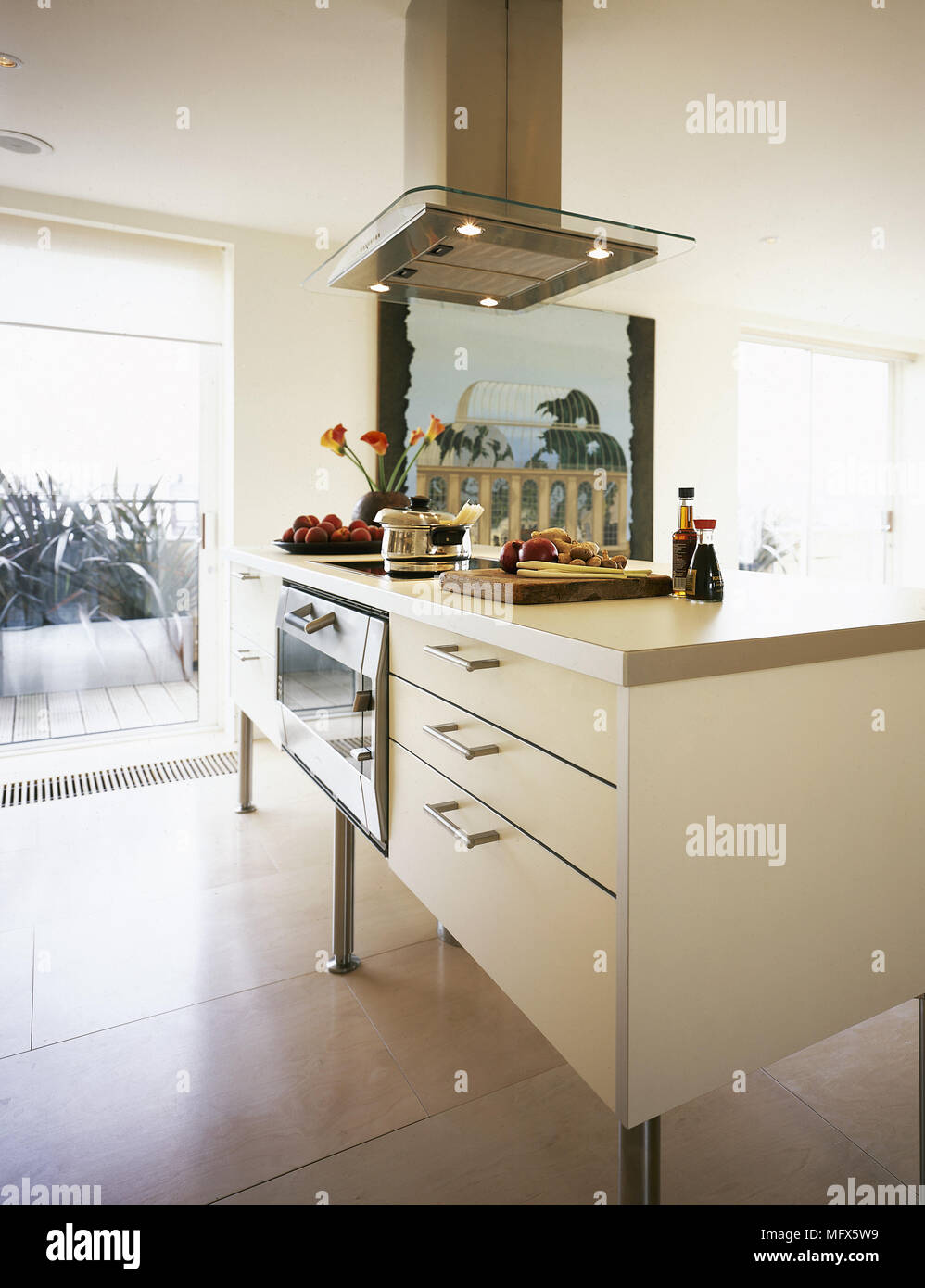 Modern, open kitchen with a tiled floor, central island unit ...