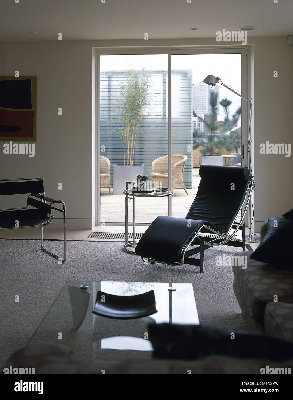 Modern Sitting Room With A Carpeted Floor Leather Recliner Sofa