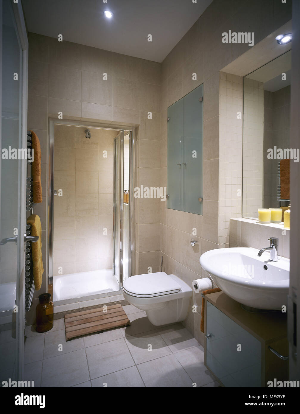 Modern Bathroom With A Tiled Floor Shower Room Toilet Mirror And