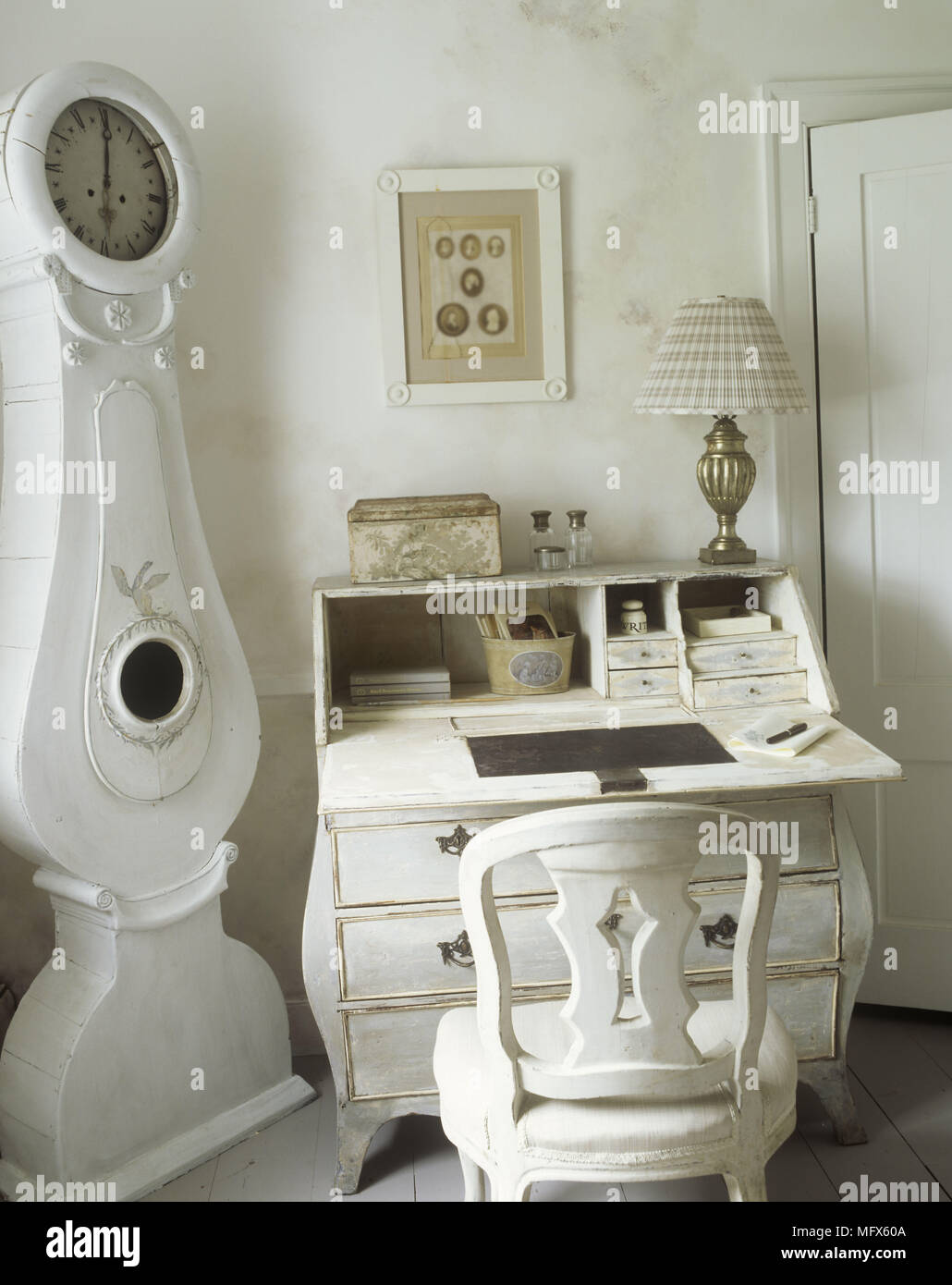 A detail of a traditional country room Swedish style white painted furniture Gustavian clock & A detail of a traditional country room Swedish style white painted ...
