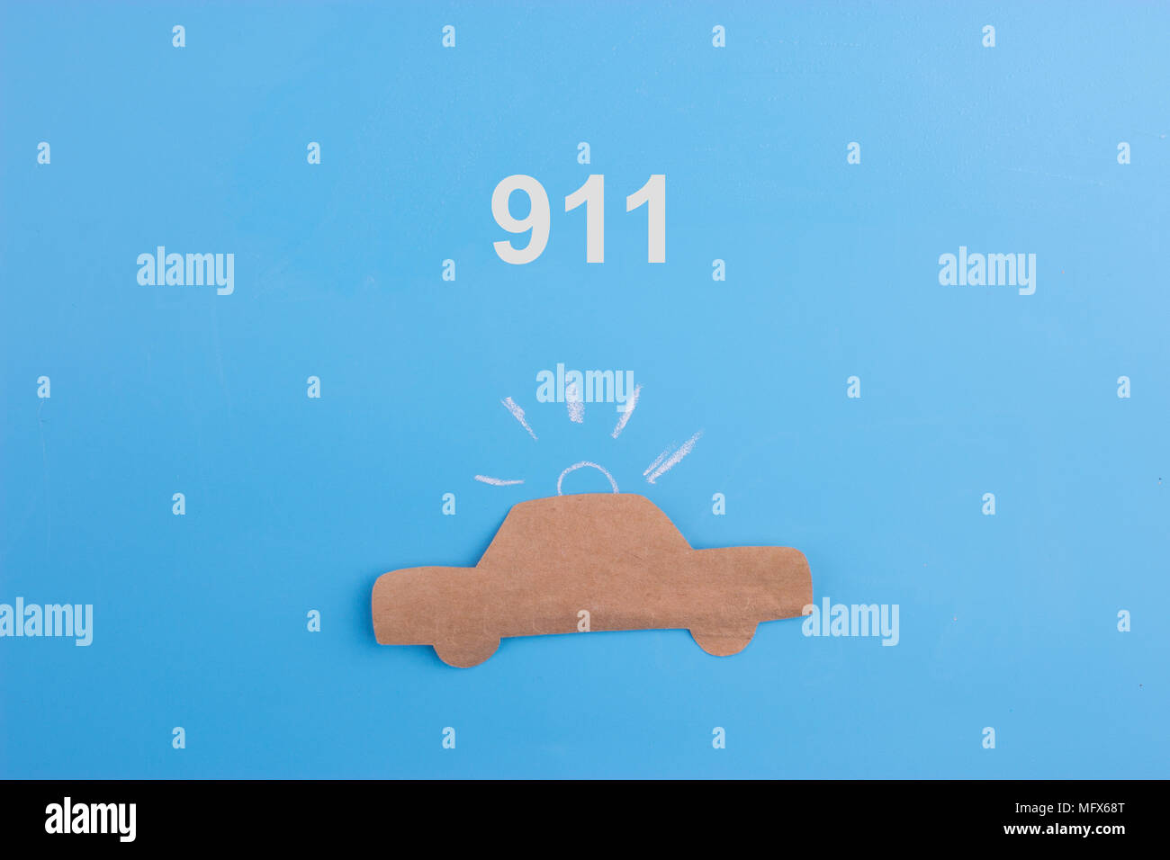 emergency car concept. paper car on blue background - Stock Image