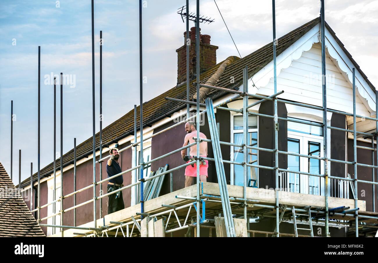 scaffolders at work Stock Photo