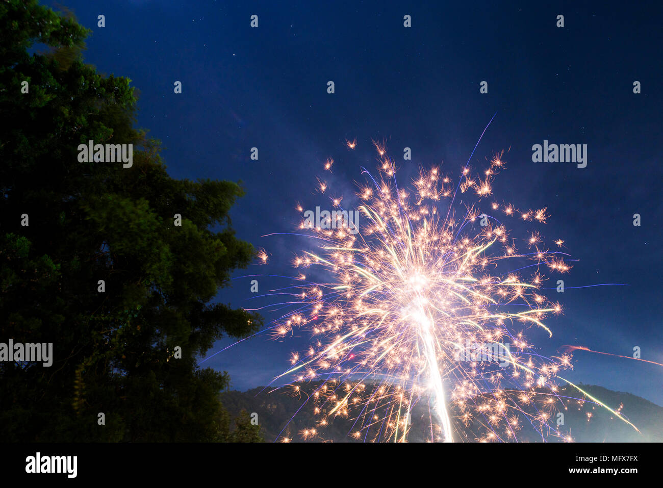 Fireworks light up the night sky on New Years Eve in Guatemala - Stock Image