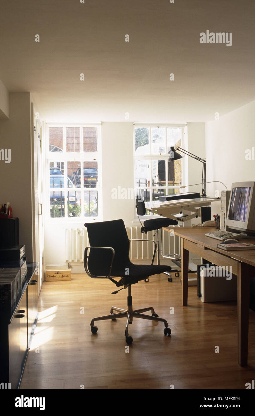 Eames Office Chair In Home Office With Drawing Board Stock Photo