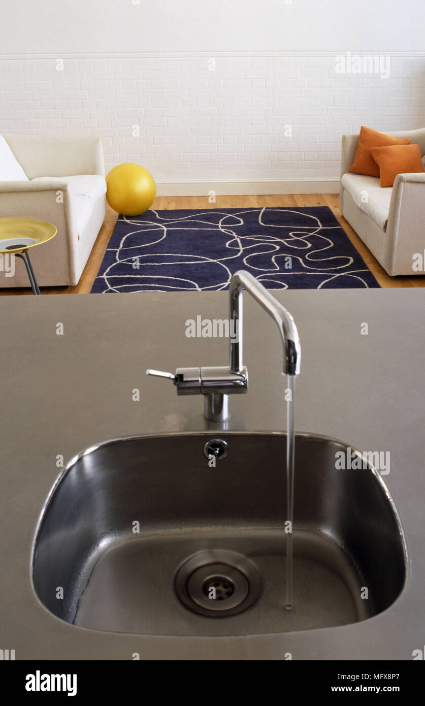 Water Running From Tap Fitting On Sink Set In Stainless ...