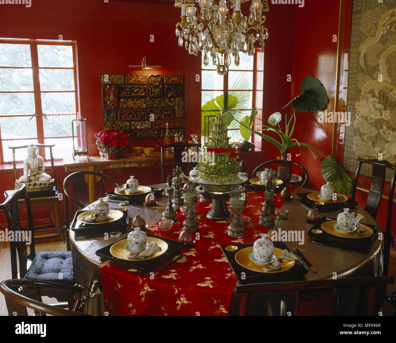 Chandelier Suspended Over Table Set In An Oriental Style For Dinner Party Red Dining Room