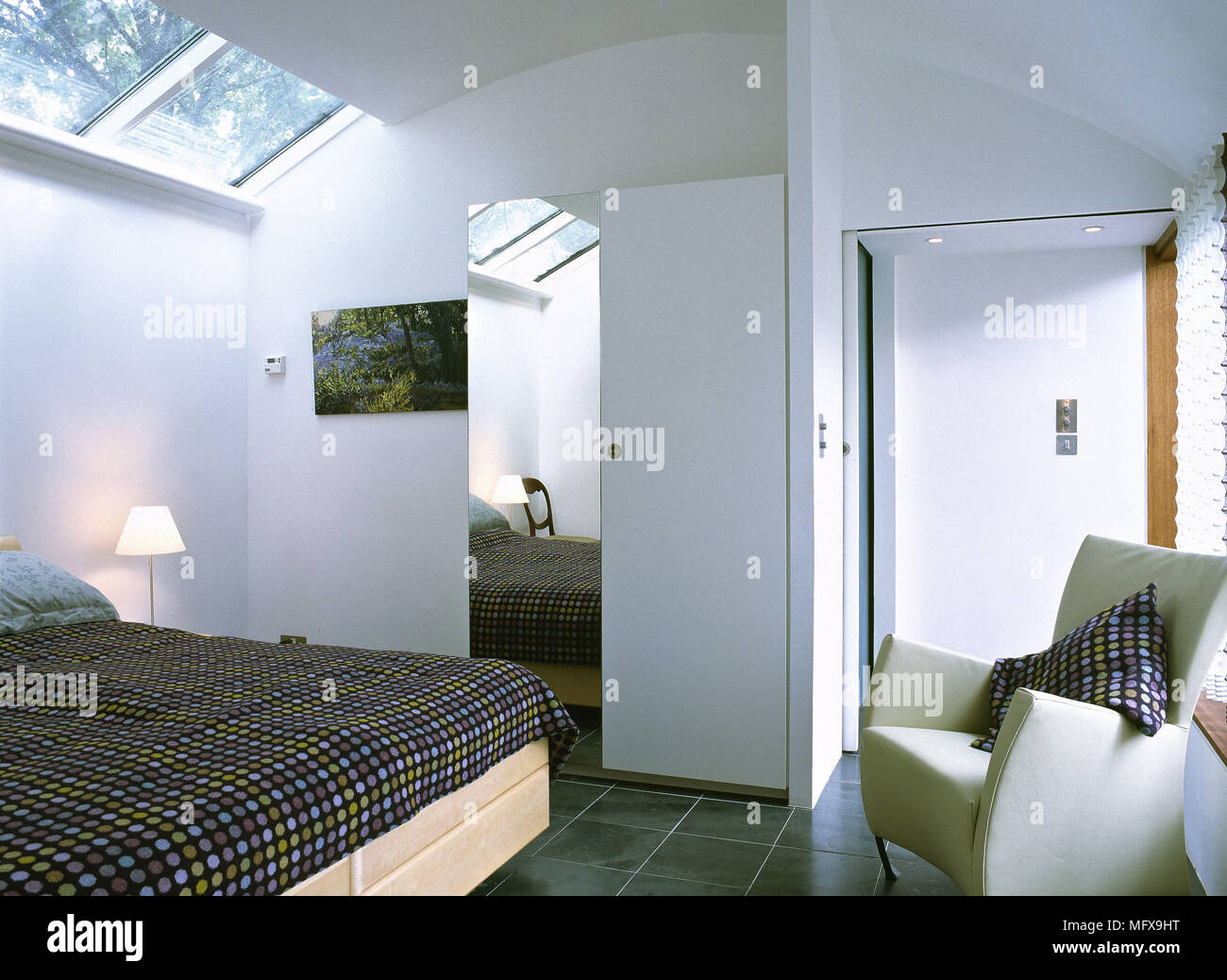 Attic Bedroom With Curved Ceiling And Skylights.   Stock Image