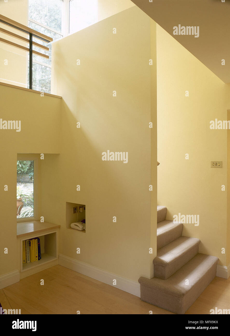 modern open plan hallway with yellow walls stock photo 181901886
