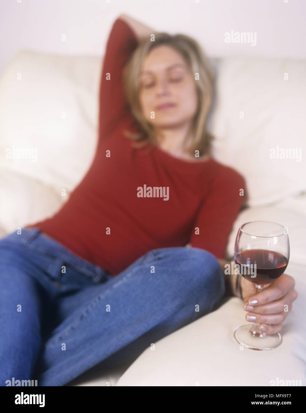 Astounding Woman In Red Top And Blue Jeans Sitting On White Sofa With Inzonedesignstudio Interior Chair Design Inzonedesignstudiocom