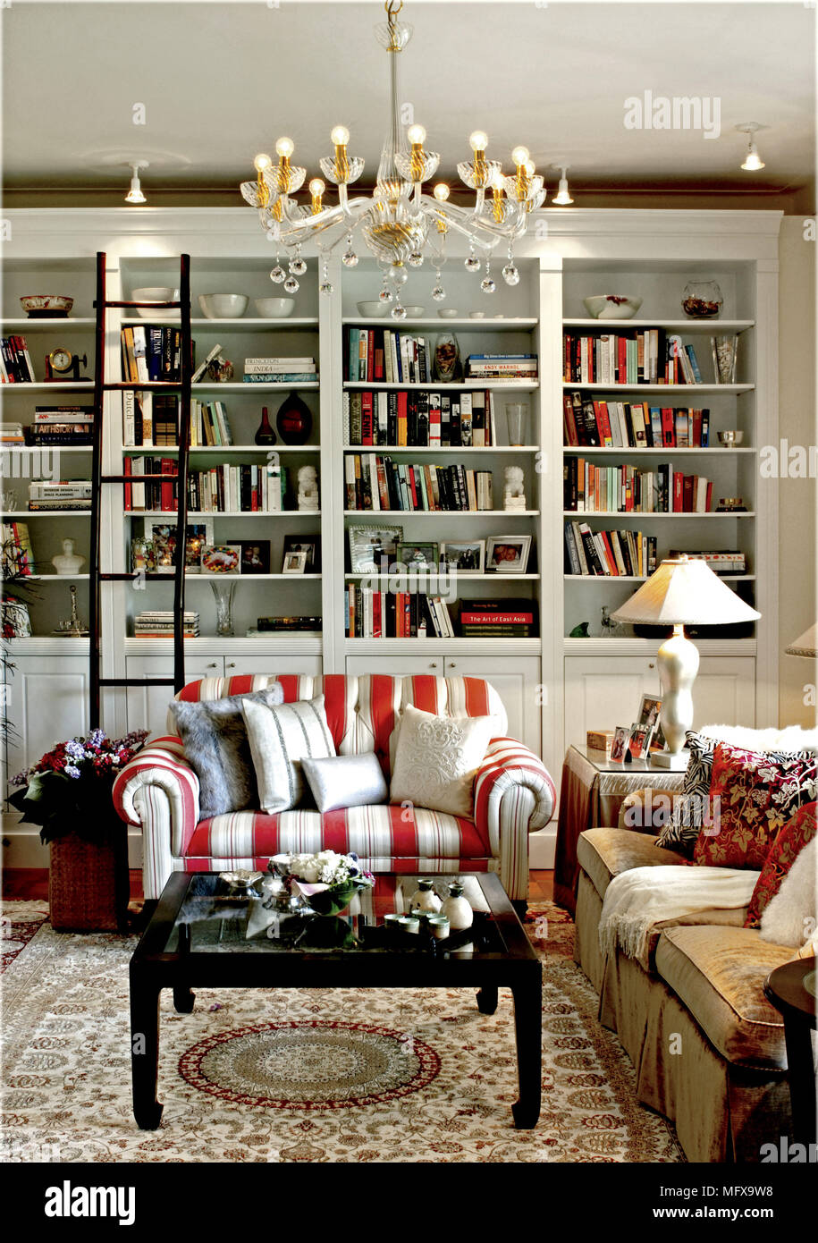 Black Wood Coffee Table In Front Of Red And White Stripe Sofa In